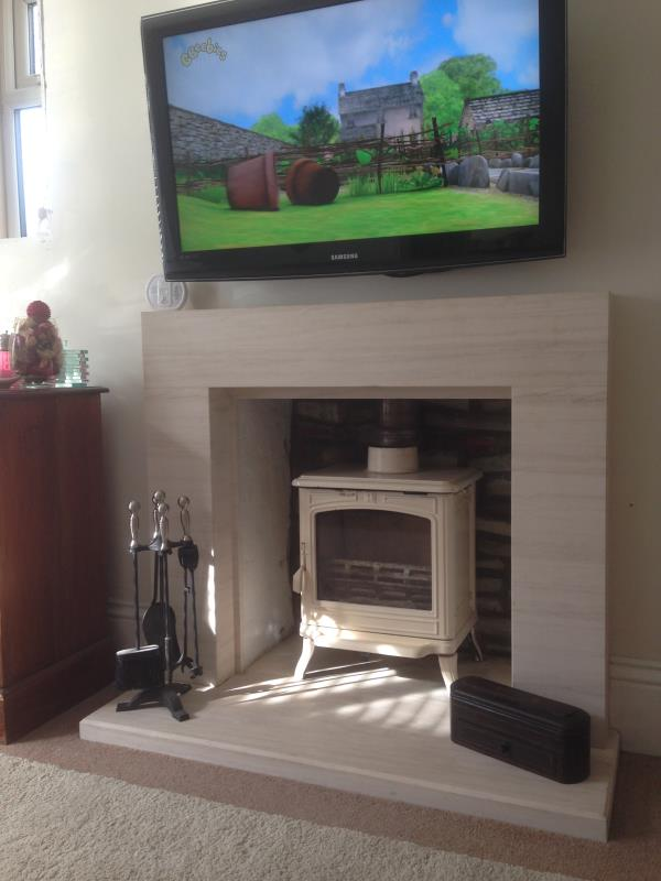 Faro Limestone Fireplaces and Franco Belge Stove