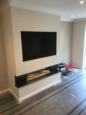 An Evonic Fire and Built Chimney Breast